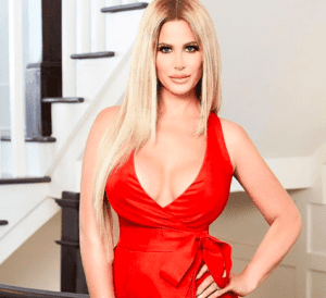 Kim Zolciak-Biermann Posing In Red Dress