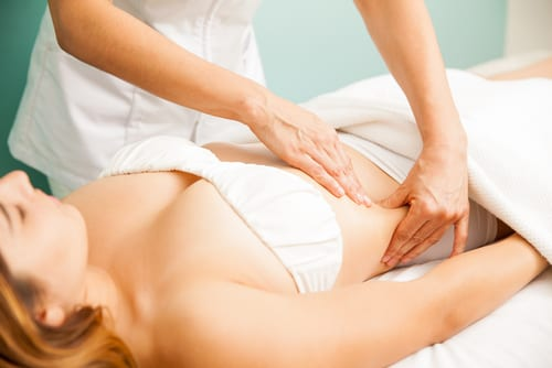 Beautiful young woman getting a lymphatic massage at a health and beauty spa-img-blog