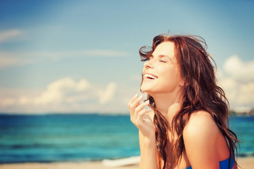 bright picture of laughing woman on the beach-img-blog