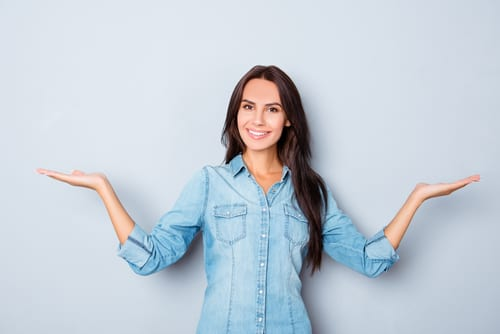 Happy smiling woman gesturing with hands and shown balance-img-blog