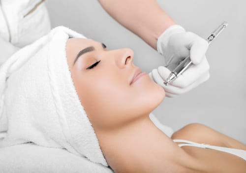 face of beautiful woman while procedure jet peeling, facial treatment-img-blog