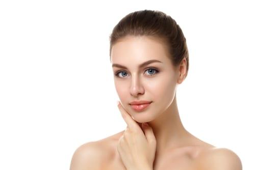 young beautiful caucasian woman touching her face-img-blog