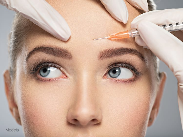 A woman demonstrating an injectable filler procedure to get rid of fine lines and wrinkles.