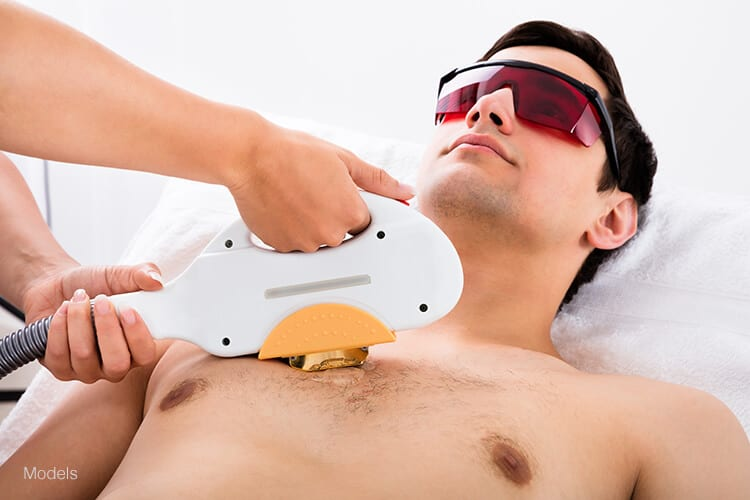 A young man receives a laser hair removal treatment on his chest. Laser hair removal can be a safe and effective way for men to get rid of unwanted hair along the body and face.