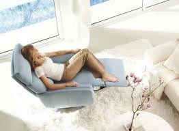 Woman sitting in recliner